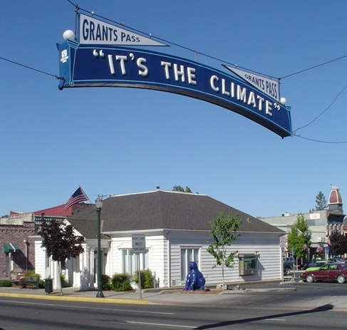 "Grants Pass, Oregon - ""it's the climate"" official sign"